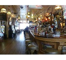 Haunted? What sits on the 2nd bar stool in front? Photographic Print