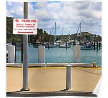 No Parking Sign beside a Harbour Poster