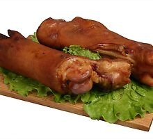 Smoked trotters on wooden board. by fotorobs