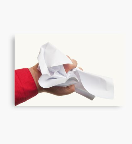 Crumpled paper in hand Canvas Print