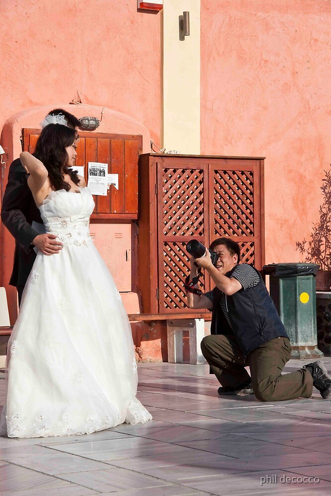 Wedding Photographer On His Knee by phil decocco