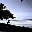 Woman Sweeping Beach by vanyahaheights