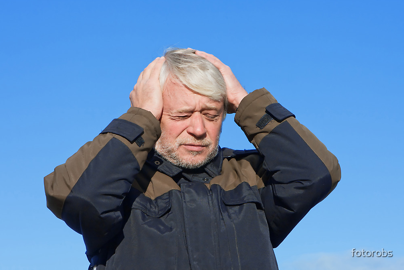 Portrait of middle-aged man on blue sky of the background. by fotorobs