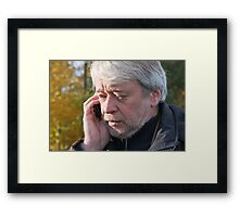 Portrair of mature middle-aged man in forest. Framed Print