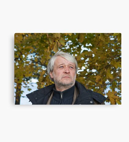 Portrait of middle-aged man in autumn day. Canvas Print