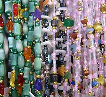 "Colourful necklaces for sale in a ""tourist trap"" by logonfire"