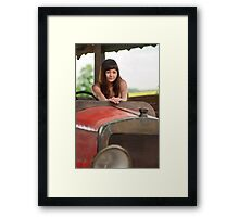 Young woman with old car. Framed Print