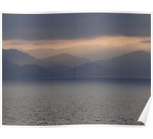 The mountains of the Sierra Madre silhouetted against the sunset sky Poster