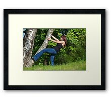Young woman with tree. Framed Print