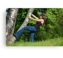 Young woman with tree. Canvas Print