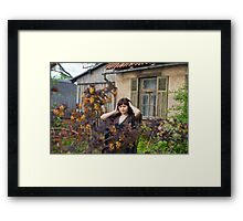 Beauty girl in garden. Framed Print