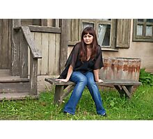 Beauty girl near the old house. Photographic Print