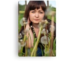 Portrait of beauty girl with dandelions. Canvas Print