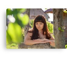 Portrait of beauty girl in nature. Canvas Print