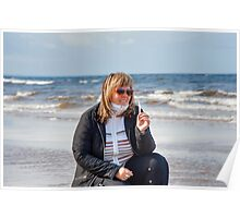 Woman relaxing at the sea. Poster