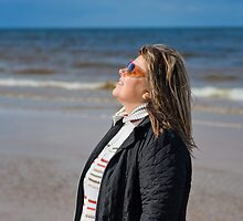 Portrait of woman at the sea by fotorobs