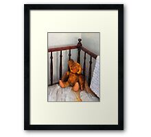 Teddy Bear in Crib Framed Print
