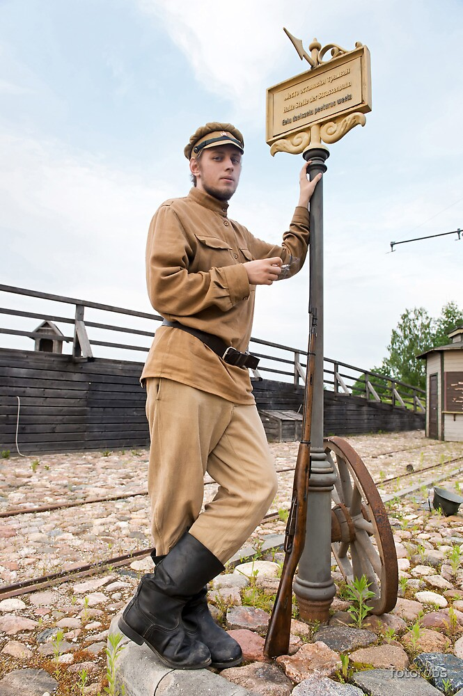 Retro style picture with soldier at tram stop. by fotorobs