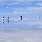 People floating on Heaven on Earth, Salar de Uyuni, Bolivia by Camila Gelber
