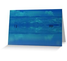 People in the distance floating on Salar de Uyuni, Bolivia Greeting Card