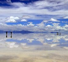 People gliding on the glorious Salar de Uyuni, Bolivia by Camila Gelber