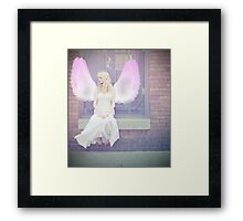 One day she'd have real wings, and fly away from this place, but for now she would dream... Framed Print