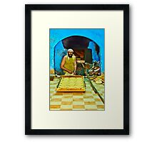 The Baker Framed Print