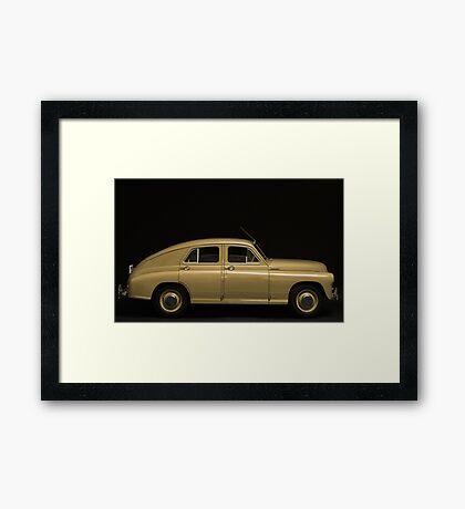 retro car side view on a black background Framed Print