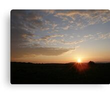 Distant Grainan sunset Canvas Print