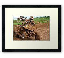 Quad bike on dirt track Framed Print