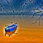 Boat in snow with blue sky by Tania Koleska