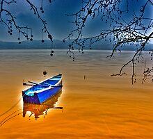 Boat in snow with blue sky by Tania Koleska