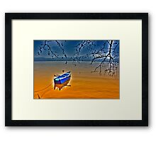 Boat in snow with blue sky Framed Print