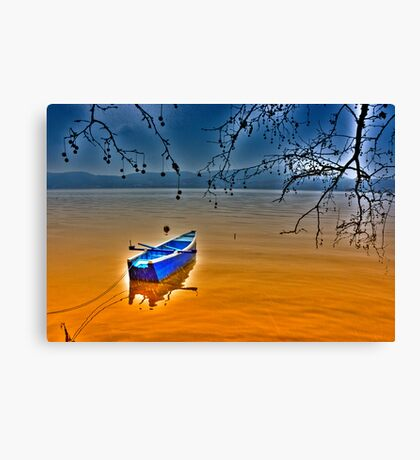 Boat in snow with blue sky Canvas Print