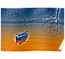 Boat in snow with blue sky Poster