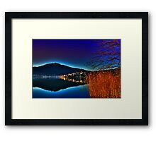view of a city at sunset time Framed Print
