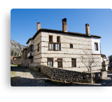 Traditional house at corner of the street Canvas Print