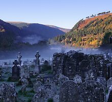 Graveyard in mist, Glendalough, County Wicklow, Ireland by Andrew Jones
