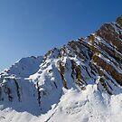 Alpine peak and sun by Walter Quirtmair