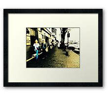 Movement on a city street at midday Framed Print