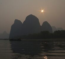 Sun Behind the Mountains by yewenyi