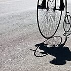 Penny-farthing shadow by Cecily  Graham