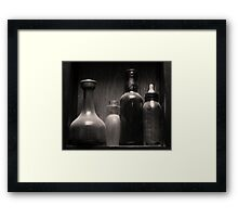 Four Antique Bottles Framed Print