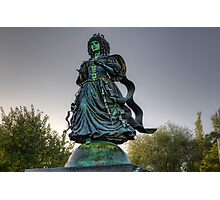 Interesting statue near river Photographic Print