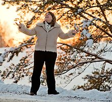 Woman on winters sunset by fotorobs