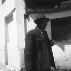 Old Man on the wall, Lijiang by Giles Freeman