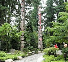 Totem poles at Capilano, Vancouver, Canada by logonfire