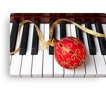 Christmas ornament on piano keys Canvas Print
