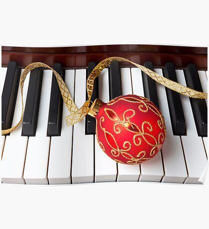 Christmas ornament on piano keys Poster