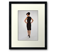 Woman in black dress Framed Print
